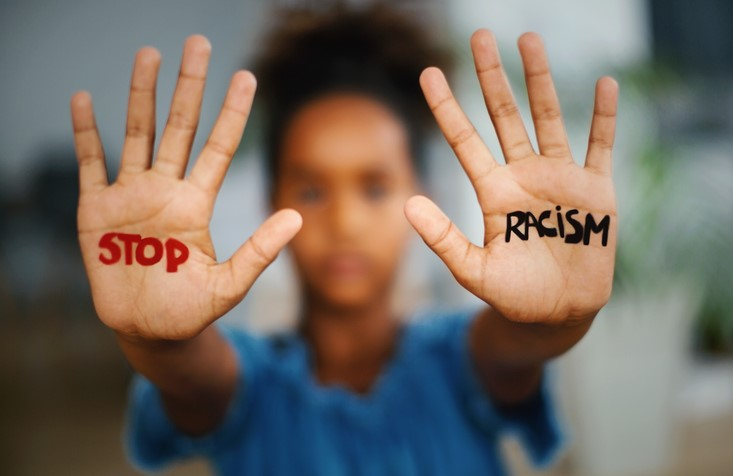 hands with the words stop racism